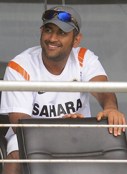 Indian captain Mahendra Singh Dhoni sits in the dressing room after the second day of the first Test match between Sri Lanka and India was called off due to rain in Galle. (AFP Photo)