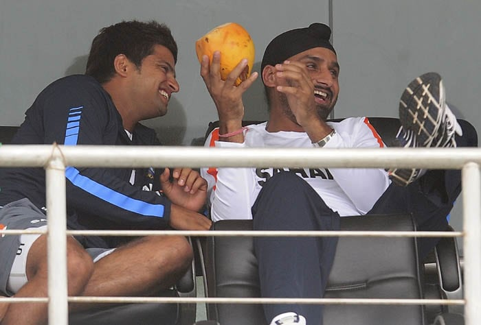 Suresh Raina shares a light moment with Harbhajan Singh after the second day of the first Test match between Sri Lanka and India was called off due to rain in Galle. (AFP Photo)