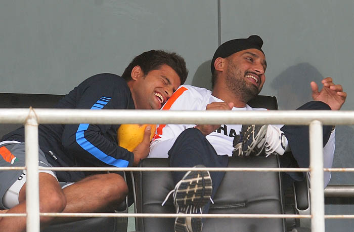 Suresh Raina shares a light moment teammate Harbhajan Singh after the second day of the first Test match between Sri Lanka and India was called off due to rain in Galle. (AFP Photo)