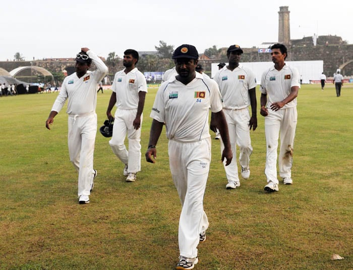 Sri Lankan cricketers leave the ground led by Muttiah Muralitharan at the end of the third day of the first Test match between Sri Lanka and India at the Galle International Stadium in Galle. (AFP Photo)