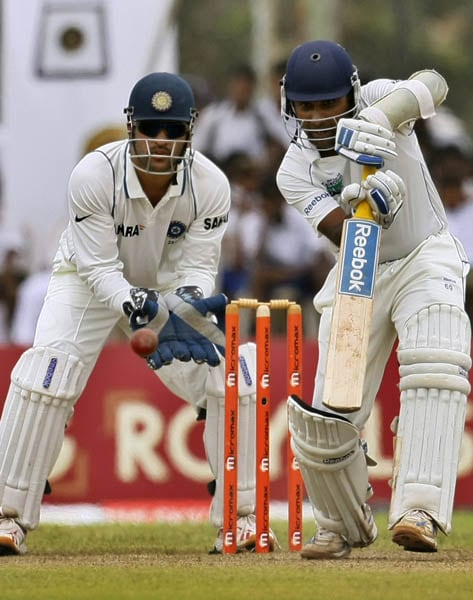 Mahela Jayawardene plays a shot as Mahendra Singh Dhoni takes position on the third day of their first Test in Galle. (AP Photo)