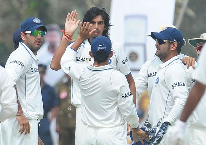 Ishant Sharma celebrates with teammates the dismissal of Tharanga Paranavitana during the third day of the first Test match between Sri Lanka and India in Galle. (AFP Photo)