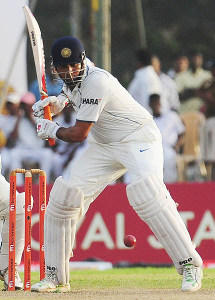 VVS Laxman plays a stroke during the third day of the first Test match between Sri Lanka and India in Galle. (AFP Photo)