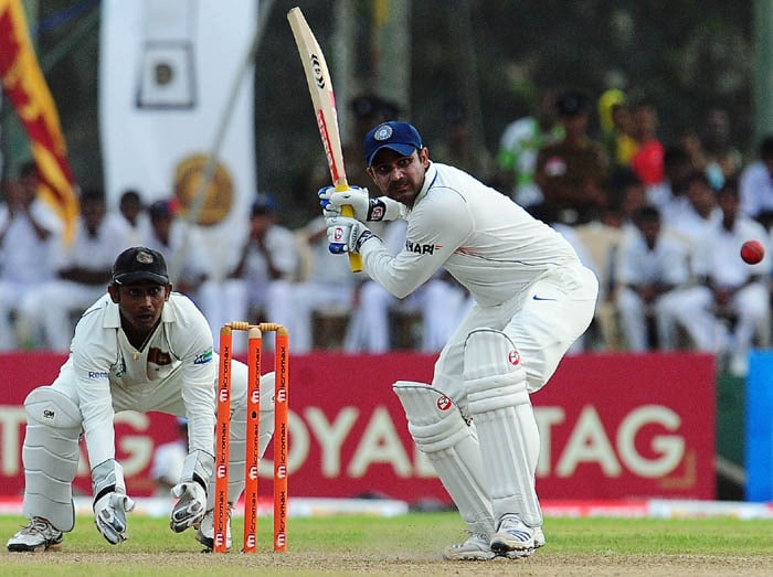 Virender Sehwag runs between wickets as Prasanna Jayawardene looks on during the third day of the first Test match between Sri Lanka and India in Galle. (AFP Photo)