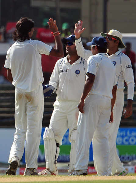 Ishant Sharma celebrates with his teammates after the dismissal of Tharanga Paranavitana during the first day of the second Test match between Sri Lanka and India in Colombo. (AFP Photo)