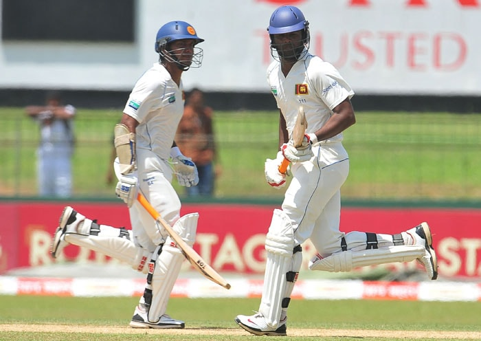 Kumar Sangakkara and teammate Tharanga Paranavitana run between the wickets during the first day of the second Test match between Sri Lanka and India in Colombo. (AFP Photo)