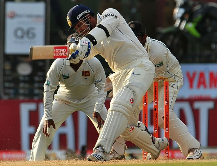 Virender Sehwag plays a stroke during the second day of the second Test match between Sri Lanka and India at the Sinhalese Sports Club Ground in Colombo. (AFP Photo)