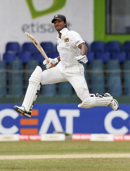 Kumar Sangakkara celebrates as he scores a double century on the second day of the second Test against India in Colombo. (AP Photo)