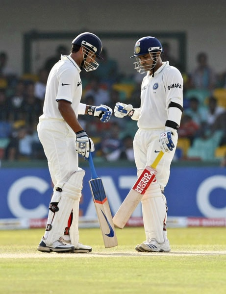 Murali Vijay and Virender Sehwag interact during the second day of the second Test between India and Sri Lanka in Colombo. (AP Photo)