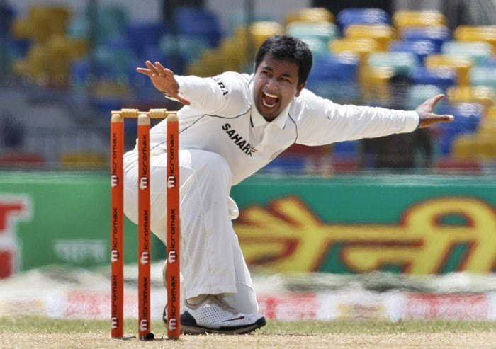 Pragyan Ojha unsuccessfully appeals for the wicket of Mahela Jayawardene during the second day of their second Test in Colombo. (AP Photo)