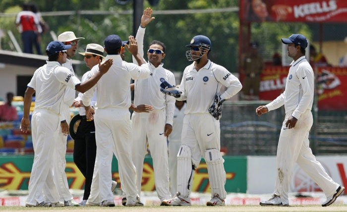 Virender Sehwag celebrates with teammates the wicket of Kumar Sangakkara during the second day of the second Test in Colombo. (AP Photo)