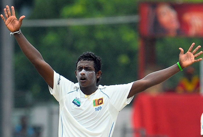 Ajantha Mendis unsuccessfully appeals for a Leg Before Wicket (LBW) decision against Pragyan Ojha during the fifth and final day of the second Test match between Sri Lanka and India in Colombo. (AFP Photo)