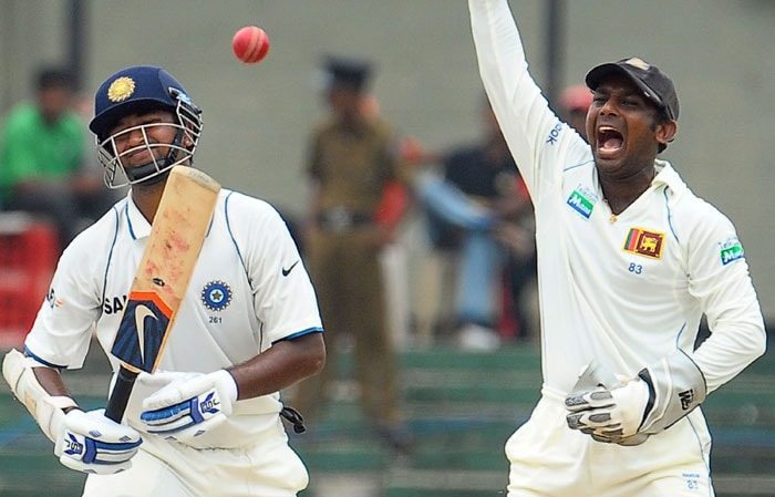Prasanna Jayawardene unsuccessfully appeals for a Leg Before Wicket (LBW) decision against Pragyan Ojha during the fifth and final day of the second Test match between Sri Lanka and India in Colombo. (AFP Photo)