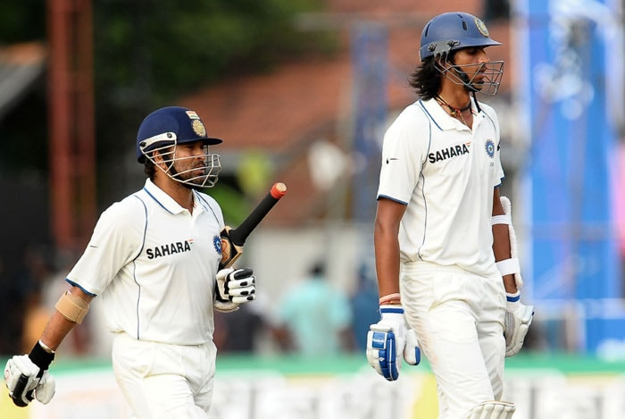 Indian cricketers Sachin Tendulkar and Ishant Sharma leave the ground at the end of the fourth day of the third Test at The P. Sara Oval International Cricket Stadium in Colombo. At stumps India were 53 runs for the loss of three wickets as they chase a total of of 257 runs to win the third and final Test and draw the series 1-1 after Sri Lanka were bowled out for 267 in their second innings. (AFP Photo)