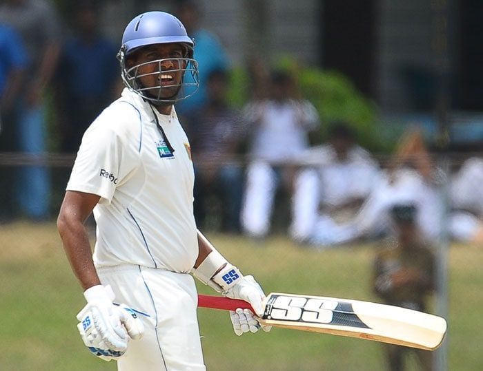Thilan Samaraweera gestures after scoring a half-century (50 runs) during the fourth day of the third Test match between Sri Lanka and India in Colombo. (AFP Photo)