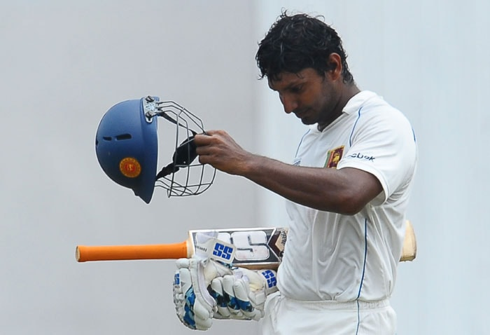 Kumar Sangakkara walks back to the pavilion after his dismissal during the fourth day of the third Test match between Sri Lanka and India in Colombo. (AFP Photo)