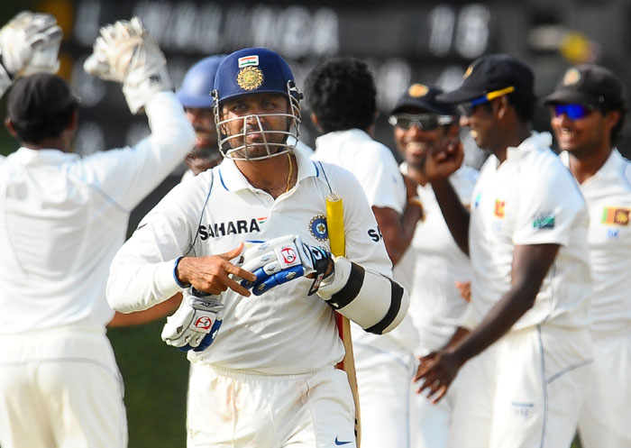Virender Sehwag walks back to the pavilion after his dismissal during the fourth day of the third Test match between Sri Lanka and India in Colombo. (AFP Photo)
