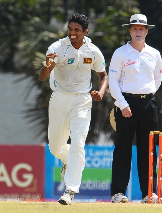 Suraj Randiv celebrates after the dismissal of Ishant Sharma during the fifth and final day of the third Test match between Sri Lanka and India in Colombo. (AFP Photo)