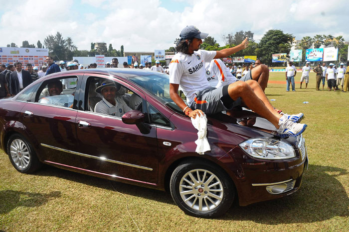 Virender Sehwag, seen in the driver's seat, gives his teammates a ride in a car presented to him after receiving the Man of The Series trophy following the third Test match between Sri Lanka and India in Colombo. (AFP Photo)
