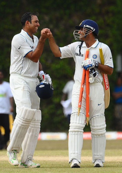 VVS Laxman and Virender Sehwag leave the grounds with stumps after their victory following the fifth and final day of the third Test match between Sri Lanka and India in Colombo. (AFP Photo)