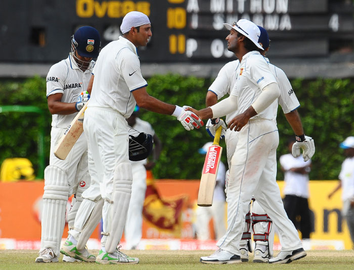 Sri Lankan captain Kumar Sangakkara congratulates VVS Laxman following the fifth and final day of the third Test match between Sri Lanka and India in Colombo. (AFP Photo)