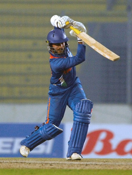 Dinesh Karthik plays a shot during the fifth ODI of the tri-series in Dhaka. (AFP Photo)