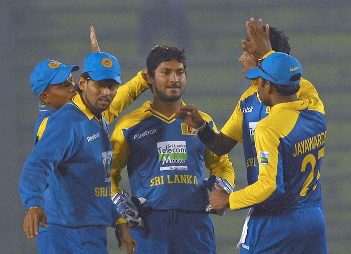 Sri Lankan cricketers celebrate the dismissal of unseen Indian cricketer Dinesh Karthik during the fifth ODI of the tri-series in Dhaka. (AFP Photo)