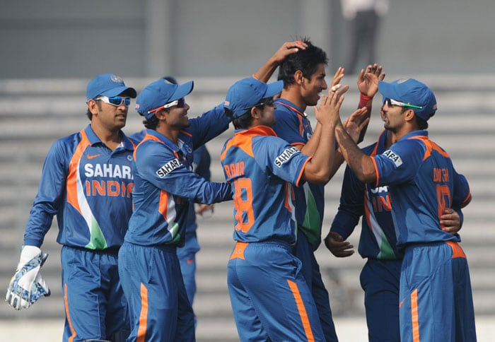 Indian cricketers congratulate teammate Sudeep Tyagi during the fifth ODI of the tri-nation tournament in Dhaka. (AFP Photo)