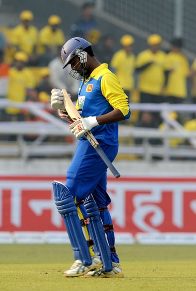 Thissara Perera leaves the ground after losing his wicket during the fifth ODI of the tri-nation tournament in Dhaka. (AFP Photo)