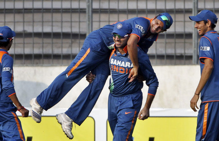 Yuvraj Singh lifts teammate Suresh Raina as they celebrate the dismissal of Thissara Perera during the fifth ODI of the tri-nation tournament in Dhaka. (AP Photo)