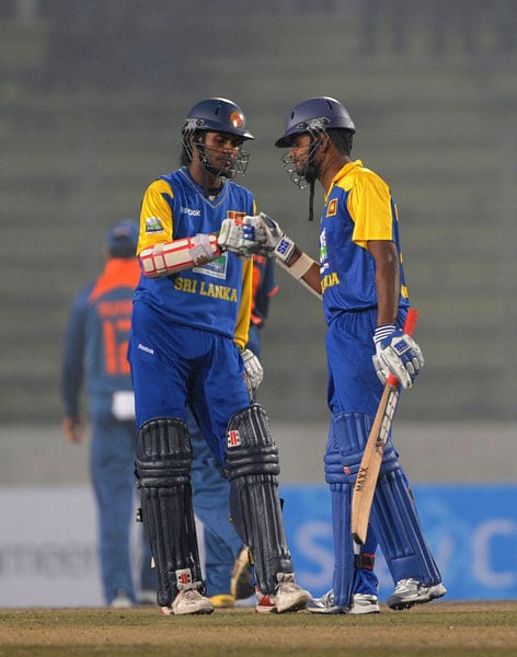 Lahiru Thirimanne and Upul Tharanga celebrate a four during the second ODI of the tri-nation tournament in Dhaka. (AFP Photo)