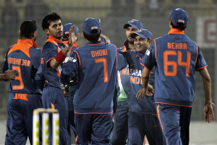 S Sreesanth celebrates with teammates the dismissal of Lahiru Thirimanna during the second ODI of the tri-nation tournament in Dhaka. (AP Photo)