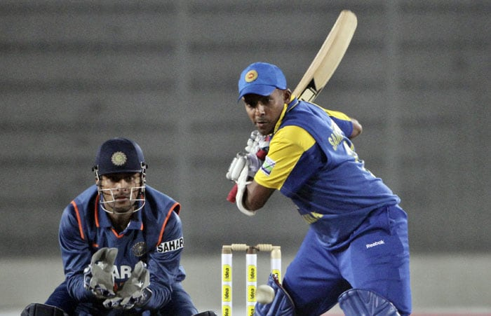 Thilan Sameraweera prepares to play a shot as Mahendra Singh Dhoni looks on during the second ODI of the tri-nation tournament in Dhaka. (AP Photo)