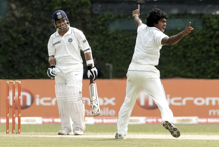 Lasith Malinga (R) celebrates after the dismissal of Indian batsman Sachin Tendulkar (L) during the third day of the third Test match between Sri Lanka and India at The P. Sara Oval International Cricket Stadium in Colombo. (AFP Photo)