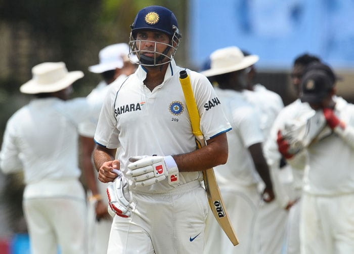 VVS Laxman walks back to the pavilion after his dismissal during the third day of the third Test match between Sri Lanka and India at The P. Sara Oval International Cricket Stadium in Colombo. (AFP Photo)