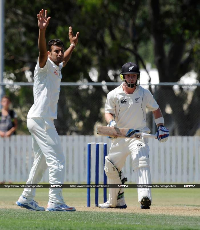 With Test specialists included against New Zealand XI in the scheduled tour match, India finally showed signs of life with rookie pacer Ishwar Pandey claiming three to force Kiwis to declare on 262/9. <br><br>In reply, India were 41/0 at stumps. <br><br>Some highlights from the match. (Images courtesy AP)