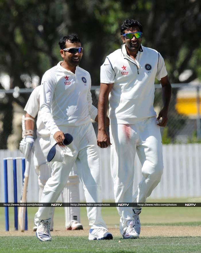 With MS Dhoni and Virat Kohli given a break, Rohit Sharma (left) led India. <br><br>He is seen here with R Ashwin who took two wickets.