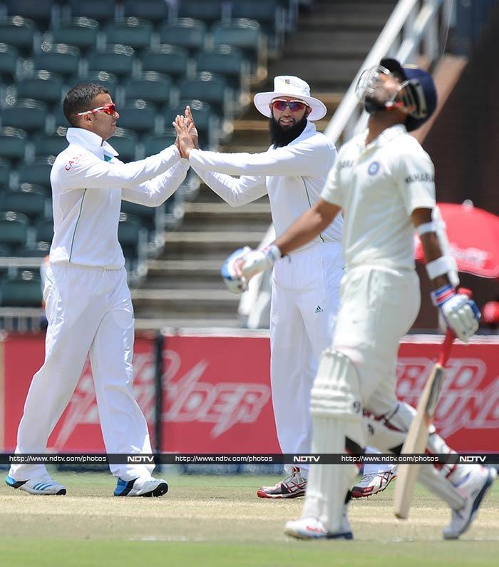JP Duminy (left) claimed two wickets including that of Ajinkya Rahane (7).