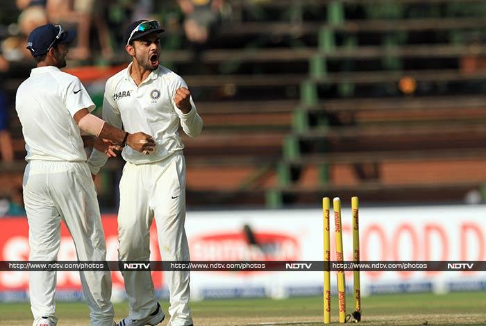 A 108-run stand for the opening wicket was ended when Rahane (left) hit the stumps to dismiss Smith on 44.