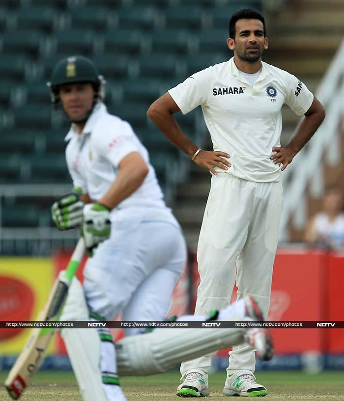 Zaheer's joy was short-lived as du Plessis and de Villiers (left in pic) anchored themselves in.