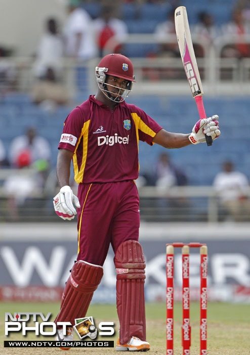 West Indies' batsman Darren Bravo raises his bat after scoring 50 runs during the fifth One-Day International against India in Kingston. (AP Photo)