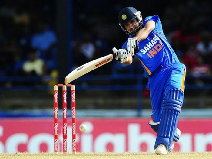 Rohit Sharma plays a shot during the first ODI between West Indies and India at the Queen's Park Oval in Port of Spain. (AFP Photo)