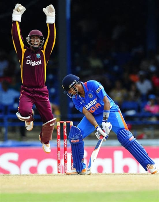Carlton Baugh celebrates after catching behind Subramaniam Badrinath during the first ODI between West Indies and India at the Queen's Park Oval in Port of Spain. (AFP Photo)