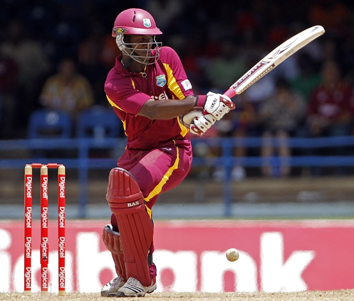 The ball bounces from the pad of Darren Sammy to be trapped LBW for 4 runs by Praveen Kumar during their first One-Day International in Port of Spain, Trinidad. (AP Photo)