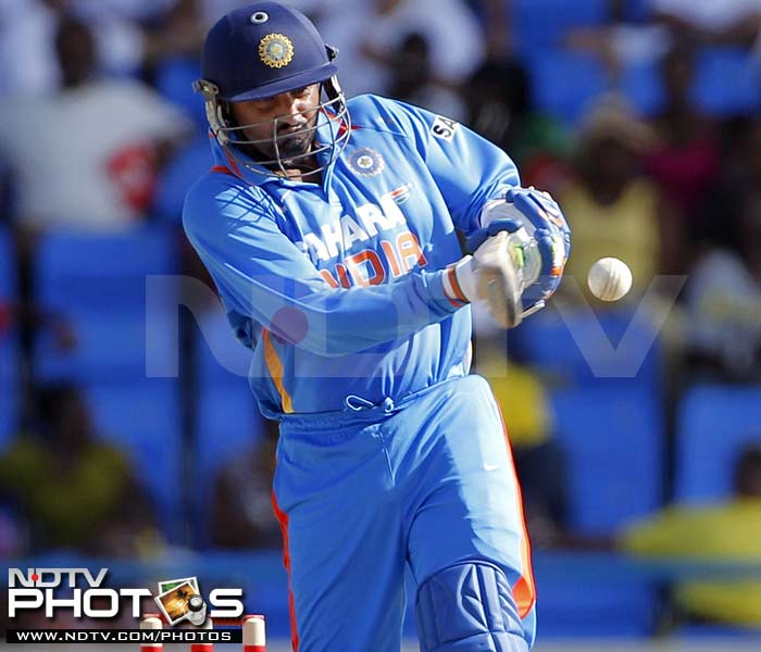 India's Harbhajan Singh bats during the third One-Day International against West Indies in St. John's, Antigua. (AP Photo)