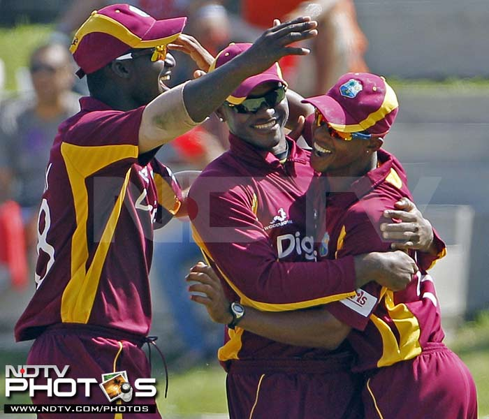 West Indies' fielder Lendl Simmons is congratulated by his captain Darren Sammy and Marlon Samuels after he took the catch to dismiss India's Yusuf Pathan for one run during their third One-Day International in St. John's, Antigua. (AP Photo)