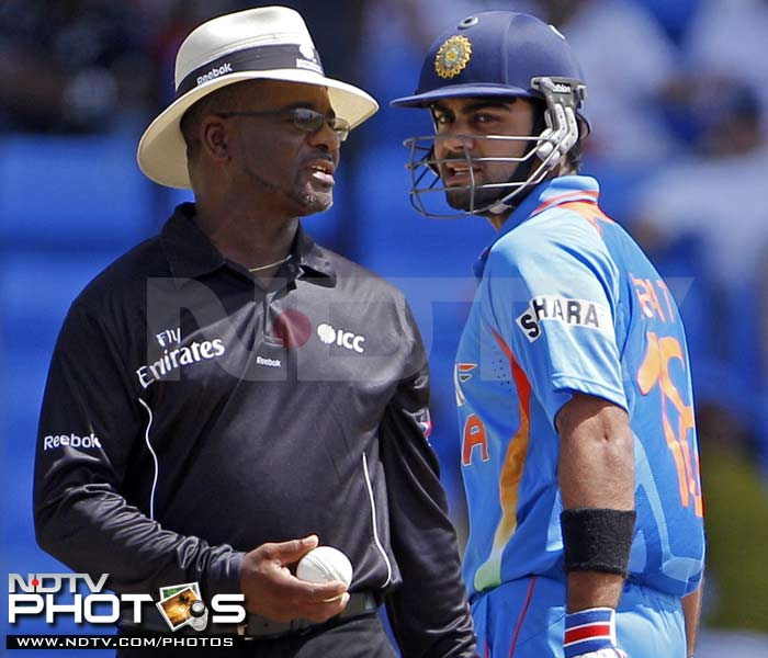 India's batsman Virat Kohli speaks to umpire Norman Malcolm after he was dismissed LBW for a duck during the third One-Day International against West Indies in St. John's, Antigua. (AP Photo)