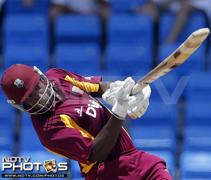West Indies' Andre Russell drives a delivery off India's Munaf Patel during their third One-Day International in St. John's, Antigua. (AP Photo)