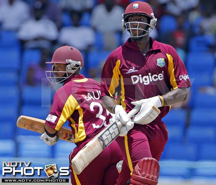 West Indies' batsmen Andre Russell and Carlton Baugh run between the wickets during the third One-Day International against India in St. John's, Antigua. (AP Photo)