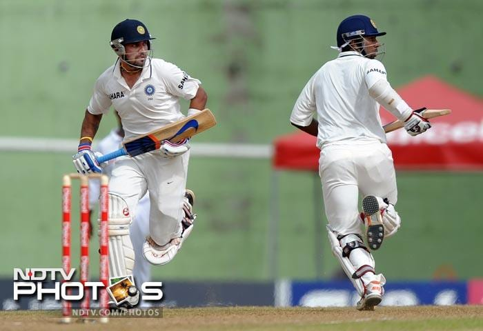 Murali Vijay and Abhinav Mukund take a run during the second day of third and final Test match between India and the West Indies at the Windsor Park Stadium in Roseau, Dominica. the West Indies scored 204 runs for the loss of all their wickets at the end of their first innings. (AFP Photo)